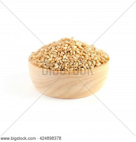Dry Organic Wheat Seed Pile In Wooden Bowl On White Background, For Carbohydrate Food Ingredient Or