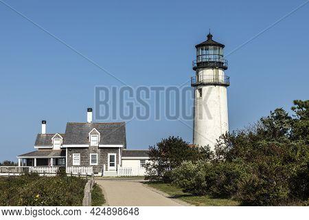 Highland Lighthouse At The Coast Of Cape Cod Under Blue Sky