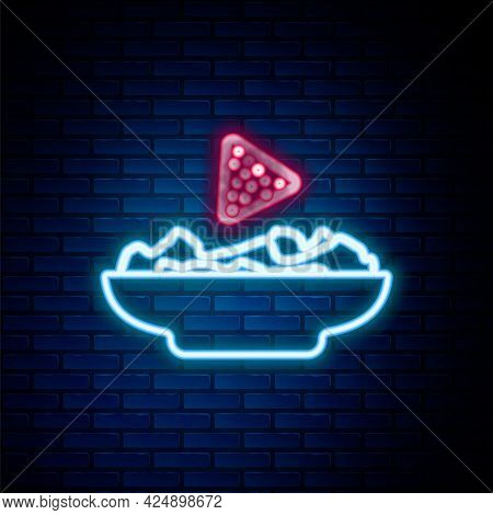 Glowing Neon Line Nachos In Plate Icon Isolated On Brick Wall Background. Tortilla Chips Or Nachos T
