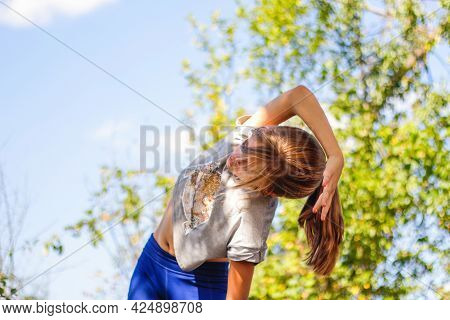 Defocus Caucasian Preteen Girl Doing Physical Exercise In Park, Forest, Outdoor, Outside. Meditation