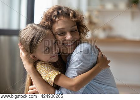 Happy Young Woman Cuddling Adorable Little Child Daughter.
