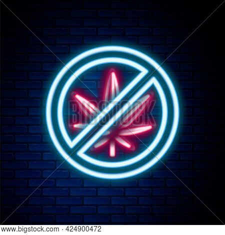 Glowing Neon Line Stop Marijuana Or Cannabis Leaf Icon Isolated On Brick Wall Background. No Smoking