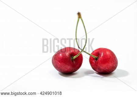 Fresh Red Cherry Isolated On White. Cherry Fruit With Copy Space For Text. Sweet Cherry Isolated On