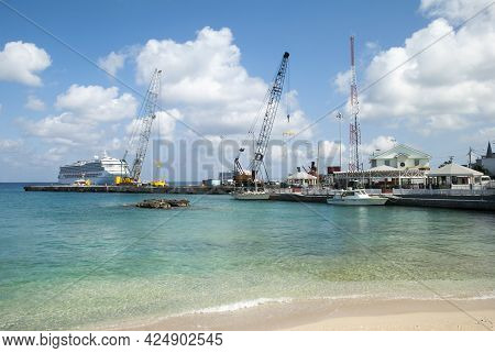 The View Of A Public Beach Near George Town Port With Cruise Ships In A Background On Grand Cayman I