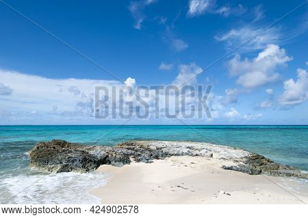 The Scenic View Of Grand Turk Island Beach With Turquoise Color Waters And Picturesque Sky (turks An