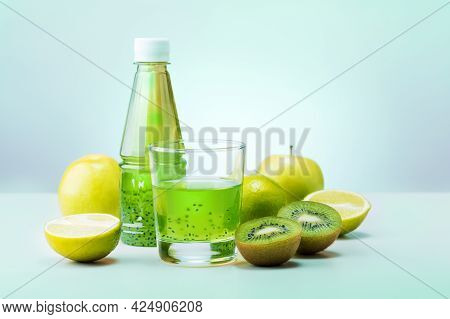 Healthy Green Detox Juice With Fruits On Mint Color Background. Vegan Meal And Detox Concept.