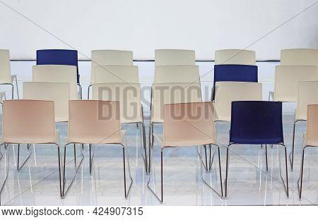Empty Chair Seats In Several Rows Inside Interior
