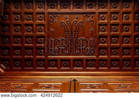 Carved Wooden Doors Of Access To The Entrance Of The Church Of The Majorcan Town Of Campos