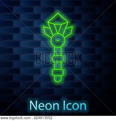 Glowing Neon Line Magic Wand Icon Isolated On Brick Wall Background. Star Shape Magic Accessory. Mag
