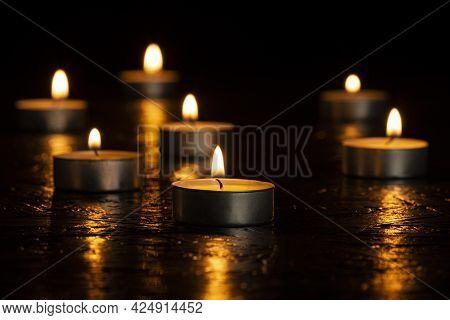 Burning Romantic Candlelight On Black Background Night