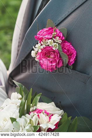 Pink Rose Boutonniere On The Groom's Grey Suit, Close-up, Wedding Element Of The Man's Decor.