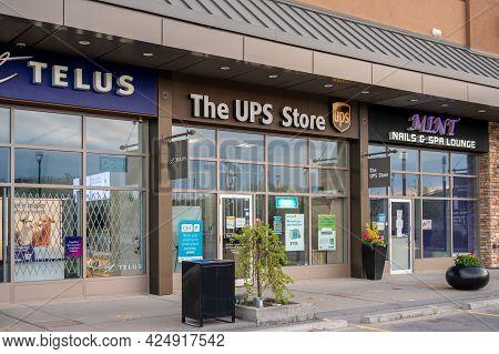 Calgary, Alberta - May 30, 2021:  Exterior Facade Of A The Ups Store In Calgary, Alberta.