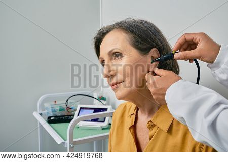 Hearing Check-up. Senior Citizen Woman Receives Tympanometry With Tympanometer Probe At Hearing Clin