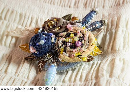Textile Brooch With Embroidered Flowers Decorated With Beads And Pearls. Handiwork.