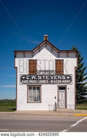 Fort Macleod, Alberta - June 13, 2021: Historic Building's Cw Stevens Building In The Heart Of Fort