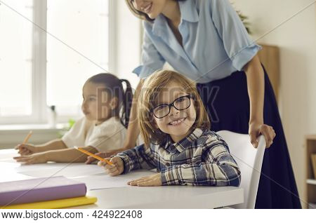 Portrait Of Smart Clever Primary School Student In Eyewear Smiling To Camera