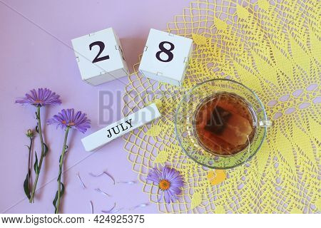 Calendar For July 28: Cubes With The Number 28, The Name Of The Month Of July In English , A Cup Of