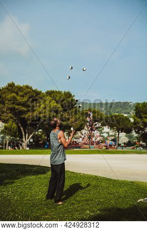 Nice, France - June 26, 2017: Juggler With Balls Outdoors In Nice Park