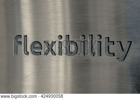 Engraving a cnc machine on a piece of metal. Engraving flexibility text