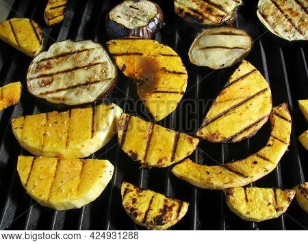 Grilled Pumpkin And Eggplant Slices On The Grill Pan. Rustic Style.
