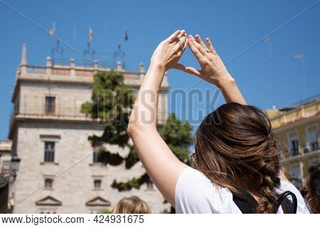 Valencia Spain. June 26, 2021-a Woman Makes A Feminist Symbol With Her Hands During A Demonstration