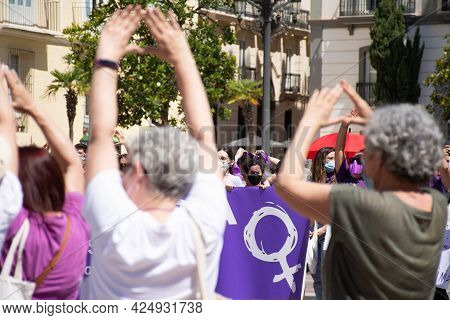 Valencia Spain. June 26, 2021 - Banner With The Feminine Symbol Among Women In A Demonstration In De