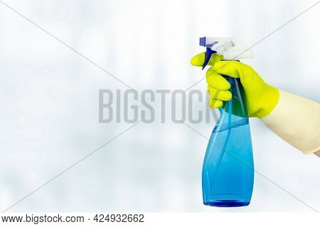 Spring Cleaning Concept. Hand Holding Spray Bottle. Woman Holding Bottle Of Detergent On White Backg