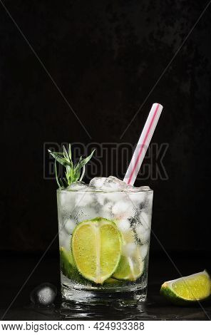 Glass Of Lime Lemonade On A Dark Background. Vertical Frame, Selective Focus. Homemade Drink With Li