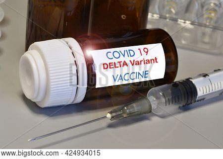 Covid-19 Delta Variant Strain Vaccine. Syringe And Vaccine. Treatment For Coronavirus Covid-19.