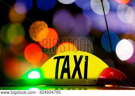 Bucharest, Romania - January 02, 2019: Taxi At Night With Lights Signal System Works. Yellow Cab In