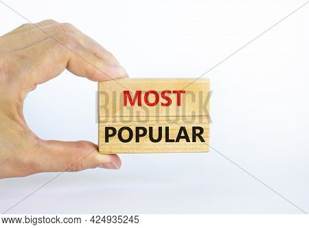 Most Popular Symbol. Concept Words Most Popular On Wooden Blocks On A Beautiful White Background. Bu