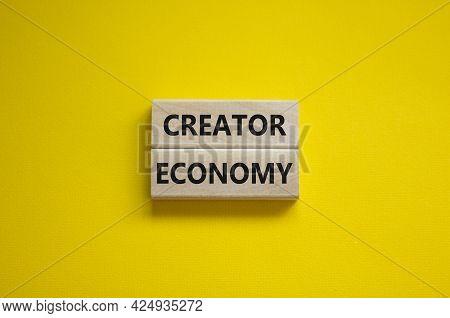 Creator Economy Symbol. Wooden Blocks With Words Creator Economy On Beautiful Yellow Background, Cop