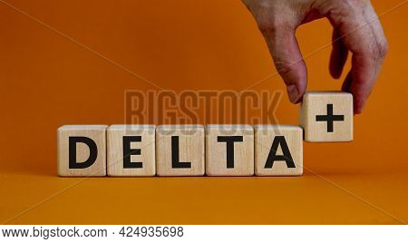 Covid-19 Delta Plus Variant Symbol. Doctor Holds The Wooden Cube And Changes Words Delta To Delta Pl