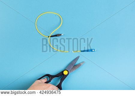Destroy Optical Sc Fiber By Scissors. Isolated On Blue