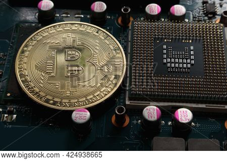Bitcoin Coin And Microprocessor On An Electronic Chip Board.