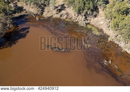 Drone Aerial Photograph Of A Polluted Small Overflow Reservoir After Severe Flooding In Yarramundi R