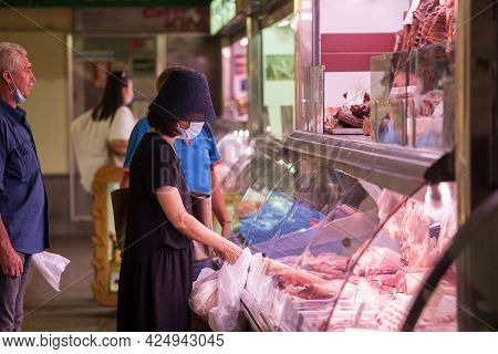 Zagreb, Croatia - June 20, 2021:  Selective Blur On A Woman Looking At Food To Buy In Dolac Trnica M