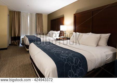 Interior Of Generic Hotel Room - Two Queen Bed Room