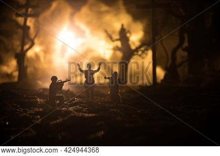 Battle Scene. Military Silhouettes Fighting Scene On War Fog Sky Background. A German Soldiers Raise