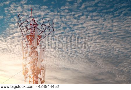 Telecommunication Tower With Blue Sky And White Clouds Background. Antenna On Blue Sky. Radio And Sa