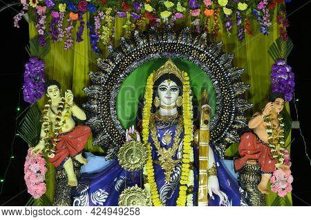 Idol Of Goddess Saraswati Being Worshipped At Night. Colorful Light On Hindu Goddess. Howrah, West B