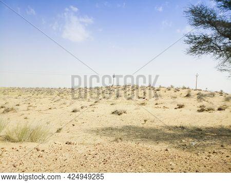 Thar Desert As Seen From Car Window. Barren Land , Sand Dunes Of Jaisalmer, Rajasthan, India.