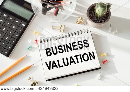 Notepad With Inscriptions Business Valuation On A White Office Background.