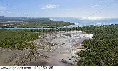 Aerial View Over Salt Pans And Bushland Out Towards The Ocean At Cape Palmerston Australia