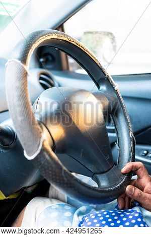 Closeup Of A Senior Man Hands On The Steering Wheel Of His Car, A Car Steering Wheel.
