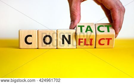 Conflict Or Contact Symbol. Businessman Turns Wooden Cubes And Changes The Word 'conflict' To 'conta