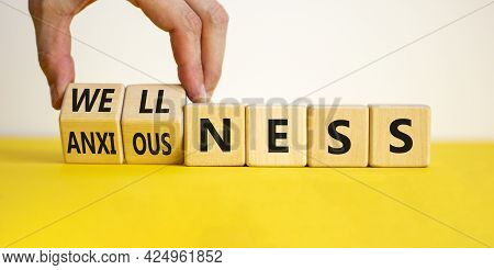 Wellness Or Anxiousness. Doctor Turns Cubes And Changes The Word 'anxiousness' To 'wellness'. Beauti