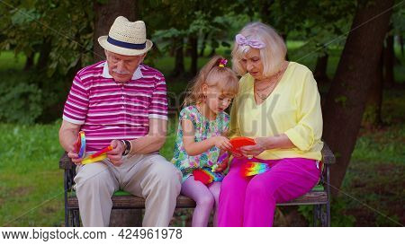 Senior Stylish Old Couple Grandmother Grandfather With Granddaughter Child Squeezing Presses Anti-st