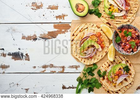 Mexican Tacos With Grilled Chicken, Avocado, Corn Kernels, Tomato, Onion, Cilantro And Salsa Old Whi
