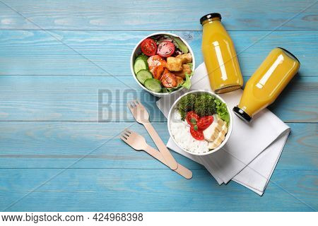 Flat Lay Composition With Healthy Takeaway Food On Light Blue Wooden Table. Space For Text